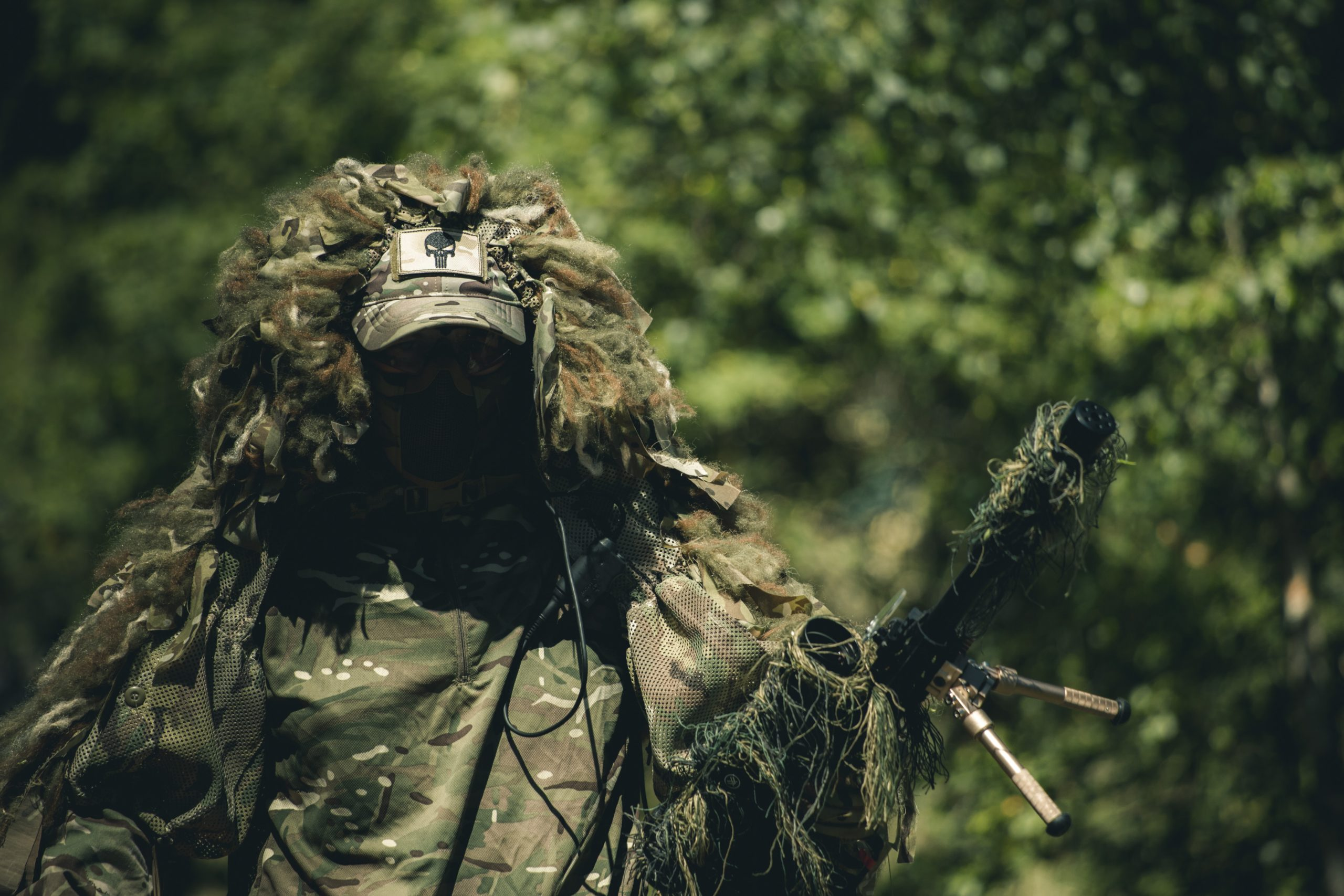 a man in the forest wearing a military poncho